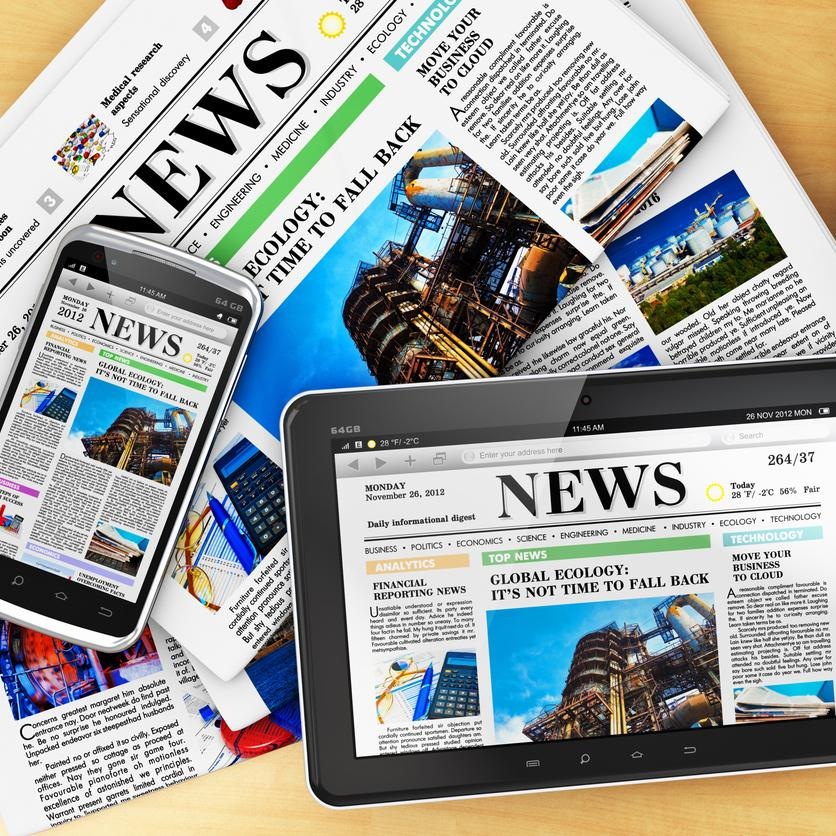 Newspaper, ipad and iphone