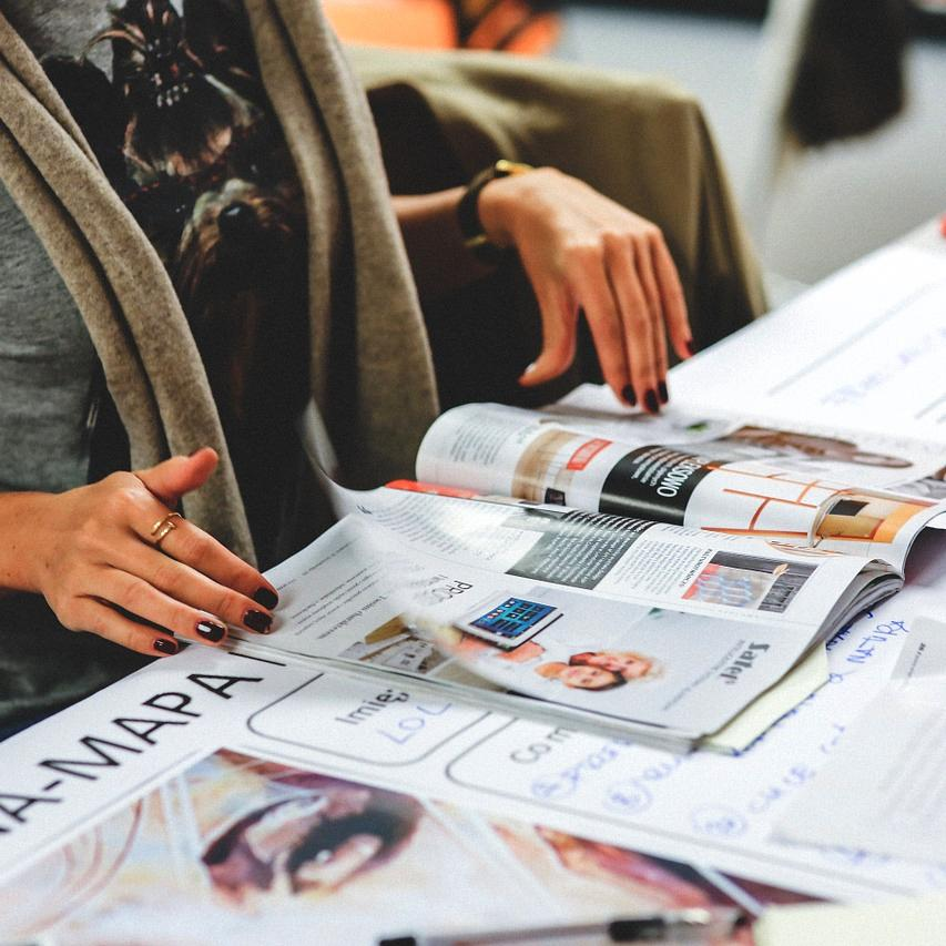 Journalism course student reading a magazine
